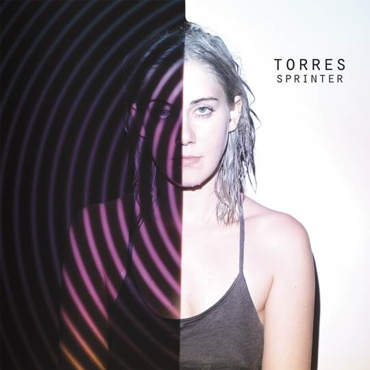 "Torres announces signing with Arts & Crafts records, shares her single ""Strange Hellos,"""
