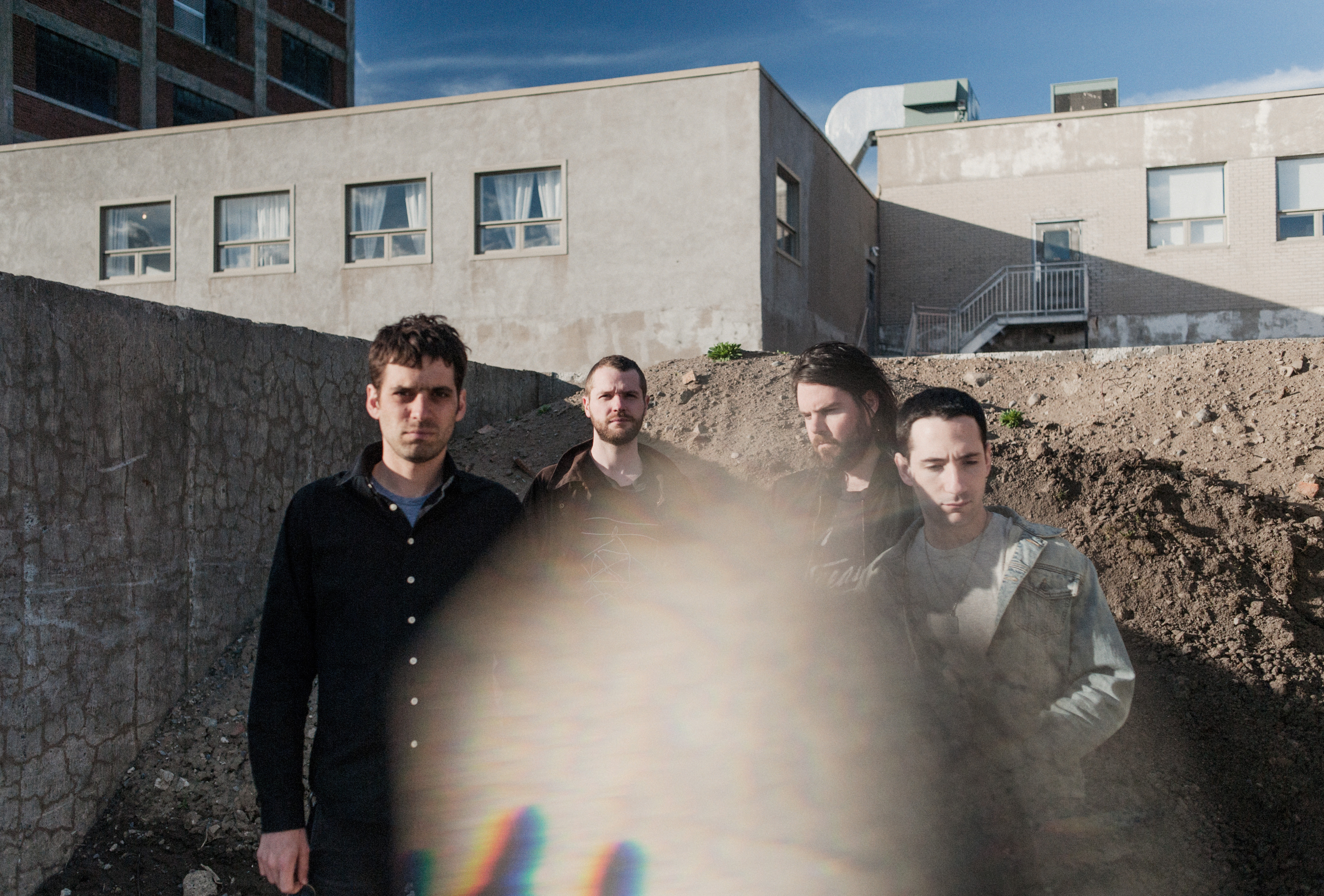 "SUUNS announce new album 'HOLD/STILL', share lead single ""Translate"""
