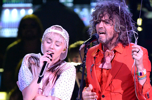"""The Flaming Lips share new lyric video for """"We A Famly"""" featuring Miley Cyrus"""