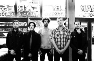 QOTSA (Queens Of The Stone Age) share teaser of their forthcoming Matador release *TK*.