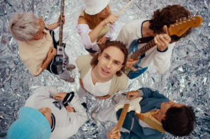 "Sports Team, have shared a new video for ""Fishing,"" directed by Kris Rimmer, captures the six-piece performing the track in a surreal studio setting"