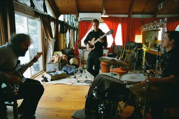 Muzz is the trio of Paul Banks (singer of Interpol), Josh Kaufman (producer/ one third of Bonny Light Horseman), and Matt Barrick (The Walkmen)
