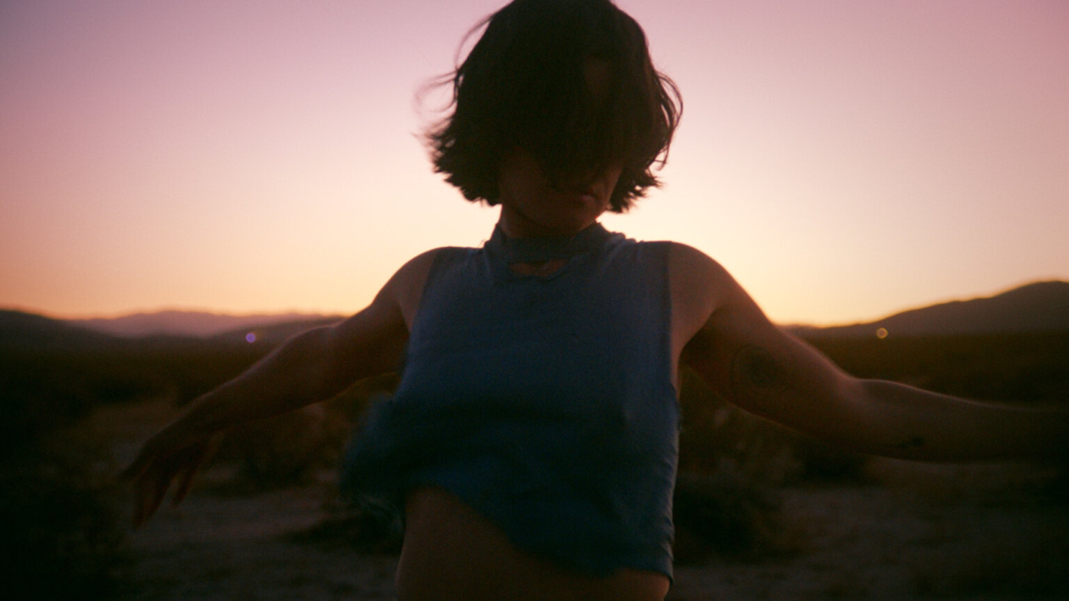 "Singer/songwriter Adrianne Lenker (Big Thief) has shares a new, self-directed video for ""forwards beckon rebound"", the track is out via 4AD"